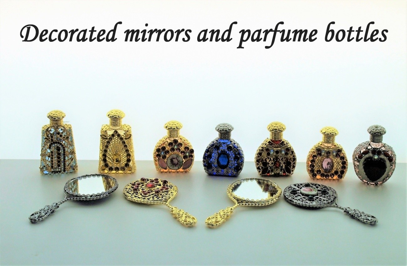 Decorated parfume bottles and pocet mirrors